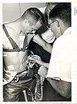 Technicians apply sensors to Scott Carpenter.jpg