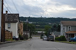 Typical scene on one of the borough's steep streets; the Conway Yard and the Ohio River are distantly visible