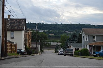 Freedom, Pennsylvania - Typical scene on one of the borough's steep streets, with the Conway Yard and the Ohio River visible in the distance