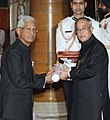 The President, Shri Pranab Mukherjee presenting the Padma Bhushan Award to Dr. Mrityunjay B. Athreya, at an Investiture Ceremony-II, at Rashtrapati Bhavan, in New Delhi on April 26, 2014.jpg