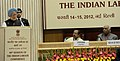 The Prime Minister, Dr. Manmohan Singh addressing the 44th session of Indian Labour Conference, in New Delhi on February 14, 2012. The Union Minister for Labour and Employment, Shri Mallikarjun Kharge is also seen.jpg