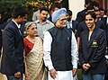The Prime Minister, Dr. Manmohan Singh and his wife Smt. Gursharan Kaur with Saina Nehwal, who won the gold in women`s singles badminton event in the XIX Commonwealth Games 2010 Delhi, in New Delhi on October 15, 2010.jpg