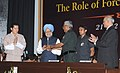 The Prime Minister, Dr. Manmohan Singh being presented a memento, at the Golden Jubilee celebrations of National Defence College, in New Delhi on October 22, 2010.jpg