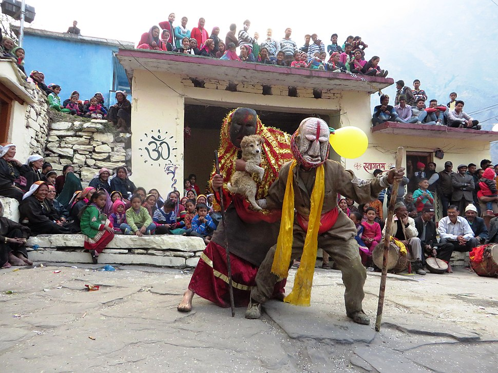 The folk characters of Latu and Lati durinɡ the mask dance festival in lata villaɡe, nanda devi national park in indian himalayas