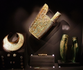 The gold quiver, shin-guards and neck armor of female in unlooted 4th Century BCE tomb of Philip II Vergina, Greece.png
