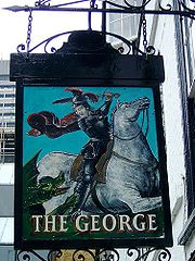 The pub sign of The George, Southwark depicting St George slaying a Dragon