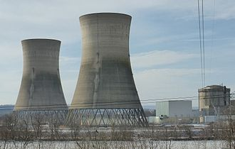 TMI-2 as of February 2014. The cooling towers are on the left. The spent fuel pool with containment building of the reactor are on the right. Three Mile Island Nuclear Generating Station Unit 2.jpg