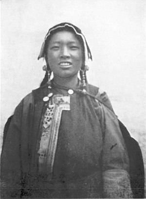 James George Scott - A Chung-Tien Tibetan girl in holiday dress, taken by Scott in 1922.