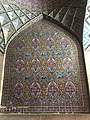 Tile facade inside the courtyard of Nasir al-Molk mosque.jpg
