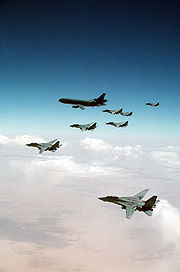 F-14 Tomcats from the Red Sea and Persian Gulf await their turn refuelling from a KC-10A over Iraq during Desert Storm while conducting a MIGCAP mission to stop fleeing Iraqi fighters.