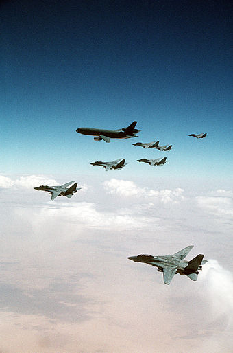 F-14 Tomcats from the Red Sea and Persian Gulf await their turn refueling from a KC-10A over Iraq during the Gulf War. - Aerial refueling