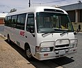 Toyota Coaster (Front view).jpg