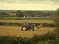 Tractor picking up bale.jpg