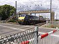 Train at Tallington Lincs railway crossing - Flickr - mick - Lumix.jpg