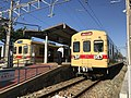 Trains at Nishitetsu-Shingu Station.jpg