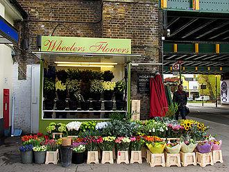 Turnham Green tube station - Flower seller outside Turnham Green station.
