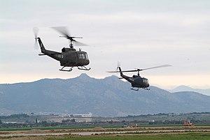 Two Hellenic Army UH-1Hs depart Megara.jpg
