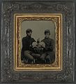 Two unidentified soldiers in Union uniforms drinking whiskey and playing cards, c1863.jpg