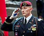 U.S. Army 1st Lt. Alexander Woody, with the 82nd Airborne Division, stands for the national anthem during a ceremony celebrating the U.S. Army's 237th birthday in Times Square June 14, 2012, in New York 120614-A-AO884-084.jpg