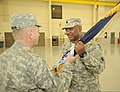 U.S. Army Lt. Col. David Fleming III, right, receives the 722nd Troop Command Brigade, Delaware Army National Guard colors from Brig. Gen. Scott E. Chambers, the assistant adjutant general of the Delaware 131207-Z-GL773-883.jpg