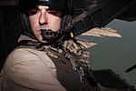 U.S. Marine Corps Cpl. Ryan P. Wells, a crew chief with Marine Heavy Helicopter Squadron (HMH) 462, provides aerial security from inside a CH-53E Super Stallion helicopter over Helmand province, Afghanistan 131007-M-SA716-028.jpg