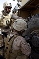 U.S. Marines with Combat Logistics Regiment 2 help Marines with the 3rd Battalion, 9th Marine Regiment change a tire during a combat logistics patrol to Forward Operating Base Payne March 23, 2013, in Helmand 130323-M-KS710-057.jpg
