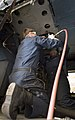 U.S. Navy Aviation Structural Mechanics 2nd Class James Nelson, left, and Notlyn Sutherland, both assigned to Helicopter Maritime Strike Squadron (HSM) 71, replace rivets on an MH-60R Seahawk helicopter Nov. 6 131106-N-AG657-013.jpg