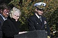 U.S. Navy Capt. Karl O. Thomas, right, the commanding officer of the aircraft carrier USS Abraham Lincoln (CVN 72), listens as Susan Cross, at lectern, the chief of chaplains at the Hampton Veterans Affairs 131108-N-XP477-130.jpg