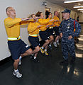 U.S. Navy Chief Aviation Warfare Systems Operator Steve Smith, right, a recruit division commander at Navy Officer Candidate School, calls out cadence to students during a physical fitness session 101023-N-IK959-457.jpg