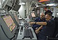U.S. Navy Gas Turbine System Technician (Electrical) 1st Class Michael Meyer, foreground, and Machinist's Mate 1st Class David Paez stand watch in the central control station aboard the guided missile cruiser 130511-N-QL471-066.jpg