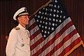 U.S. Navy Rear Adm. Dan Cloyd listens as Rear Adm. Terry B. Kraft reads his orders during a change of command ceremony in Yokosuka, Japan, Aug. 23, 2013 130823-N-DS193-053.jpg