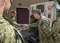 U.S. Navy Vice Adm. John W. Miller, right, the commander of U.S. Naval Forces Central Command, the U.S. 5th Fleet and Combined Maritime Forces, visits Sailors assigned to Explosive Ordnance Disposal Mobile Unit 130326-N-LX571-030.jpg