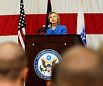U.S. Secretary of State Hillary Rodham Clinton, center, delivers a speech to more than 1,000 Sailors, Soldiers, Airmen and Marines at Andersen Air Force Base, Guam 101029-F-GU448-001 (cropped).jpg