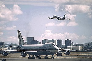 Boeing 747 on the runway and 707 in the air