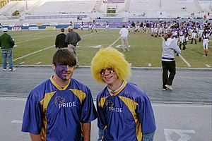 North Alabama Lions - Members of the UNA Lion Pride spirit team sporting the traditional school colors, purple and gold. The team, begun in 2007, is charged with generating school spirit not only on the athletic field but also on campus.