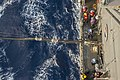 USS Antietam Sailors participate in a swim call and a replenishment at sea 160321-N-ZZ786-090.jpg
