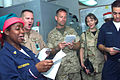 US Navy 021224-N-9867P-023 Sailors and Marines sing Christmas carols.jpg