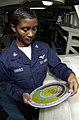 US Navy 030320-N-8273J-007 Aerographer's Mate 3rd Class Erica Harris from Warner Robins, Ga., uses a psychometric computer temperature wheel to calculate the dew point from the weather office the aircraft carrier USS Nimitz (CV.jpg