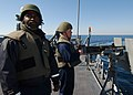 US Navy 040309-N-4374S-013 Sailors monitor surface contacts while manning a.50 caliber machine gun aboard the guided missile frigate USS Taylor (FFG 50), during a simulated small boat attack exercise (SWARMEX).jpg