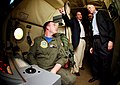 US Navy 040416-N-5821W-005 Aviation Warfare Systems Operator 2nd Class Justin Donohue shows Alabama Senator Jeff Sessions a sensor station inside one of the squadron's P-3C Orion aircraft.jpg