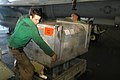 US Navy 040506-N-9047Q-004 Airman Recruit Joseph Kent and Aviation Machinist's Mate 2nd Class Delanueva work together to move an SH-60F Seahawk helicopter engine.jpg