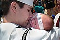 US Navy 040723-N-9288T-309 A father holds his newborn child upon his arrival to San Diego aboard USS Ronald Reagan (CVN 76).jpg