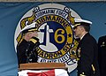 US Navy 050401-N-3527B-001 Prospective Commanding Officer, USS Albany (SSN 753), Cmdr. Mark H. Merrick, salutes Commanding Officer, USS Albany (SSN 753), Cmdr. Brett J. Genoble, as he takes over command of Albany on board Naval.jpg