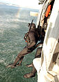 US Navy 050427-N-9500T-086 A search and rescue swimmer student jumps from a MH-60S Seahawk helicopter.jpg