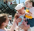 US Navy 050825-N-6639M-015 Machinist's Mate 3rd Class James Jones, assigned to USS Nashville (LPD 13), kisses his six-week-old son for the first time after returning from a deployment.jpg