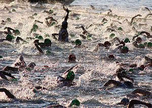 Ironman World Championship - Image: US Navy 051015 N 9419C 004 Almost 2,000 triathletes begin the 2.4 mile swim at the Ironman World Championship triathlon, held in Kailua Kona, Hawaii