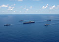 US Navy 060429-N-9621S-004 Ships assigned to the George Washington Carrier Strike group sail in formation during a strike group photo exercise.jpg