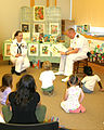 US Navy 060524-N-5324B-002 Sailors from Navy Recruiting District (NRD) Nashville read stories and sing songs to Children in the Youth Services Department of the Arkansas Main Library during Navy Week Little Rock.jpg