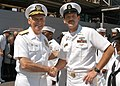 US Navy 060525-N-1371G-034 Commander, U.S. Pacific Command, Admiral William J. Fallon shakes hands with Electronic Technician Chief Petty Officer Scott Huss, stationed aboard amphibious assault ship USS Kearsarge(LHD 3).jpg