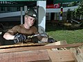 US Navy 060607-N-3532C-028 Navy Builder 2nd Class Shane Murray, a Poughkeepsie, N.Y., native and Seabee with Naval Mobile Construction Battalion Four Zero (NMCB-40), builds a table at Sulu Provincial Hospital.jpg